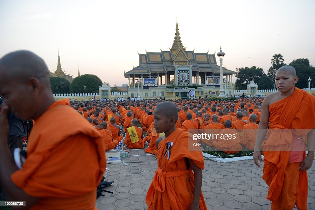 Cambodian Buddhist monks walk during a prayer ceremony in front of the Royal Palace in Phnom Penh on January 26, 2013. Tens of thousands of Cambodian Buddhist monks and people gathered to pray for the late former King Norodom Sihanouk. Cambodia's beloved former monarch Norodom Sihanouk, who died aged 89, will be cremated on February 4 following an elaborate ceremony, Cambodian Prime Minister Hun Sen said on November 26, 2012.