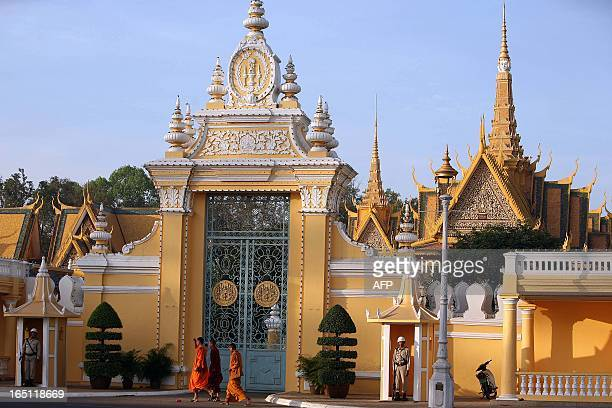 Cambodian Buddhist monks walk past the Royal Palace in Phnom Penh 21 December 2007 At least 90 percent of the Cambodian population are Buddhist...