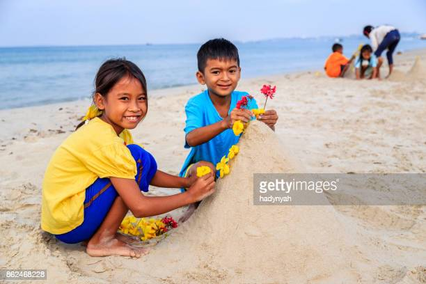 Cambodian children playing on the beach, Cambodia