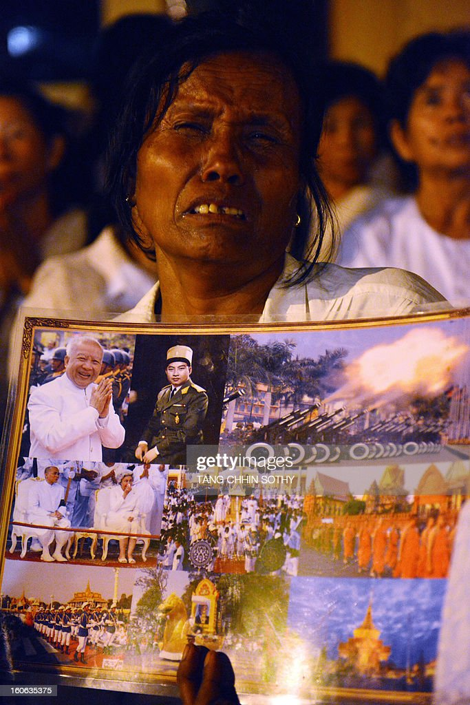 A Cambodian cries during the cremation of Cambodia's late King Norodom Sihanouk near the Royal Palace in Phnom Penh on February 4, 2013. Thousands of mourners massed in the Cambodian capital as the kingdom cremated its revered former King Norodom Sihanouk, who steered his country through six turbulent decades. AFP PHOTO/ TANG CHHIN SOTHY