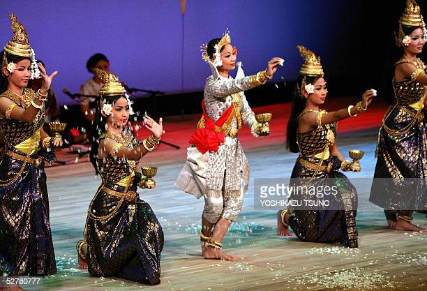 Cambodian dancers perform a traditional Khmer dance as a cultural event of the Cambodian national day ceremony at the 2005 World Expo Aichi at...