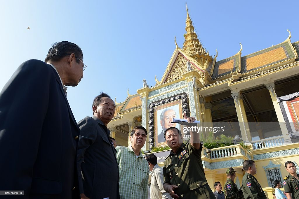 Cambodian Deputy Prime Minister Sok Ann (3rd L), Minister of National Defense General Tea Banh (2nd L) and Deputy Prime Minister Yim Chay Li (L) listen as a general (C) explains during a funeral march procession rehearsal for the late former King Norodom Sihanouk in front of the Royal Palace in Phnom Penh on January 19, 2013. Cambodia's beloved former monarch Norodom Sihanouk, who died aged 89 last month, will be cremated on February 4 following an elaborate ceremony, Cambodian Prime Minister Hun Sen said on November 26, 2012. AFP PHOTO/ TANG CHHIN SOTHY