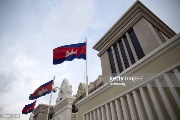 Cambodian flags fly outside the Peace Palace in Phnom Penh Cambodia on Tuesday Oct 24 2017 The International Monetary Fund projects that Cambodias...
