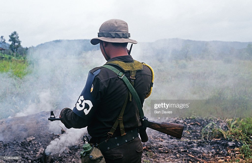Cambodian forestry police officer patrols the area around Andong Teuk in the Southern Cardamom in search of illegal charcoal kilns logging camps and...