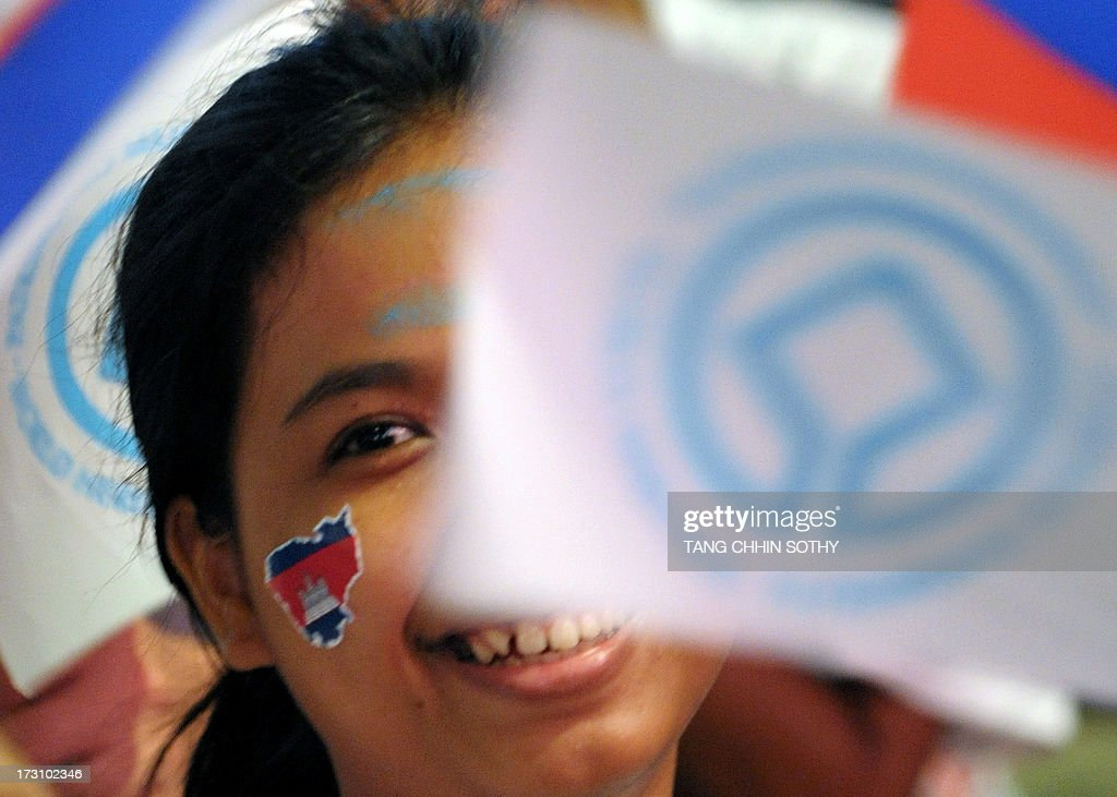 A Cambodian girl waves a UNESCO flag during an event to mark the fifth anniversary of Preah Vihear temple's world heritage listing on July 7, 2013. Cambodia on July 7 marked the fifth anniversary of the listing of the ancient 11th-century Preah Vihear temple, which has seen deadly clashes along the country's border with Thailand, as a UNESCO World Heritage site.