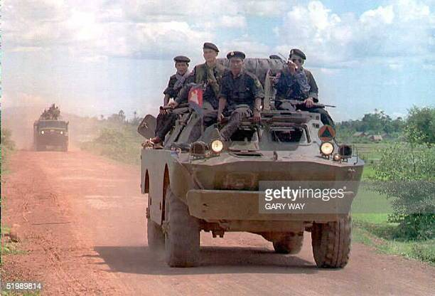 Cambodian government armored personnel carriers transport troops on national route 10 near the former military post in Treng Cambodia 08 July...