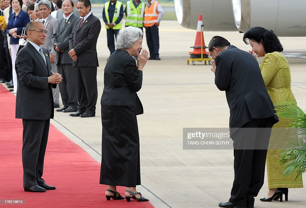 Cambodian King Norodom Sihamoni (L) and his mother, former queen Monique (C), greet Prime Minister Hun Sen (2nd R) and his wife Bun Rany (R) before departing to Beijing for medical check-ups, at Phnom Penh International Airport on August 12, 2013. Cambodia's late former king Norodom Sihanouk spent long spells in China for medical treatment.