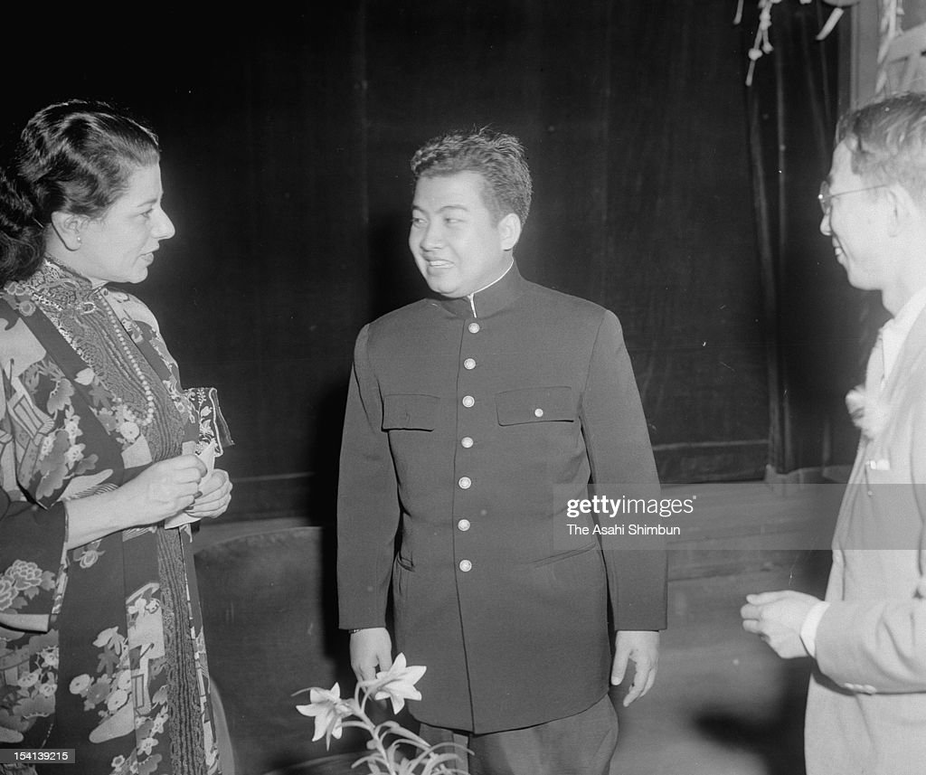 Cambodian King Norodom Sihanouk (C) visits Honganji Temple on May 11, 1953 in Tokyo, Japan.