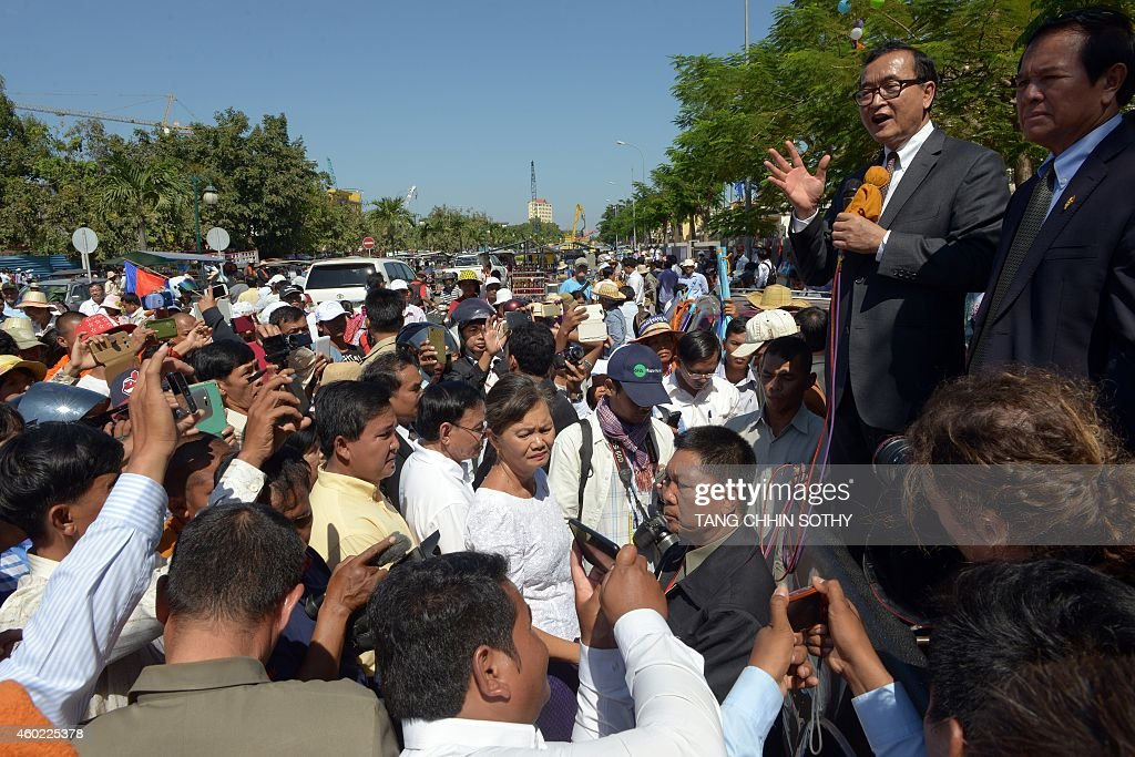 Cambodian lawmaker and opposition Cambodia National Rescue Party leader Sam Rainsy speaks to people as deputy of the CNRP and first vice president of...