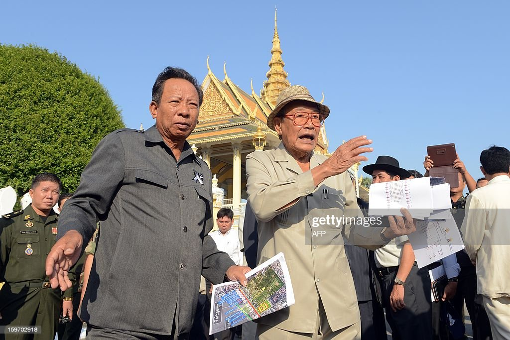 Cambodian Minister of the Royal Palace Kong Sam Ol (Center R) talks to Cambodian Minister of National Defense General Tea Banh (Center L) during a funeral march procession rehearsal for the late former King Norodom Sihanouk in front of the Royal Palace in Phnom Penh on January 19, 2013. Cambodia's beloved former monarch Norodom Sihanouk, who died aged 89 last month, will be cremated on February 4 following an elaborate ceremony, Cambodian Prime Minister Hun Sen said on November 26, 2012.