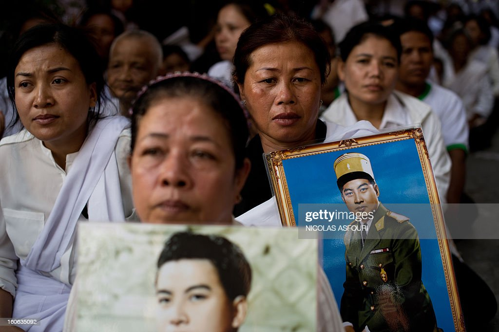 Cambodian mourners sit in a street in front of the crematorium where a coffin bearing the remains of Cambodia's late King Norodom Sihanouk is placed before his cremation, near the Royal Palace in Phnom Penh on February 4, 2013. Thousands of mourners massed in the Cambodian capital as the kingdom cremated its revered former King Norodom Sihanouk, who steered his country through six turbulent decades. AFP PHOTO/ Nicolas ASFOURI