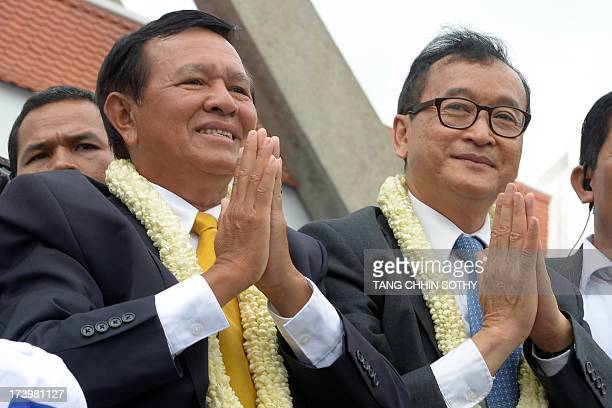 Cambodian opposition leader of the Cambodia National Rescue Party Sam Rainsy and Kem Sokha Vice president of the Cambodia National Rescue Party greet...