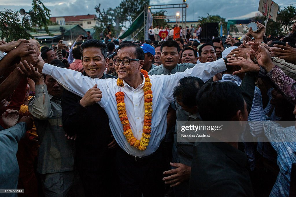 Cambodian opposition leader Sam Rainsy leaves the stage after he held a speech at Freedom Park on August 26 2013 in Phnom Penh Cambodia Cambodian...