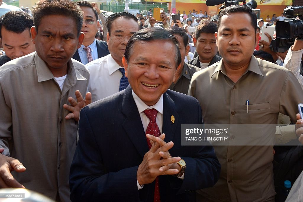 Cambodian opposition party deputy leader <a gi-track='captionPersonalityLinkClicked' href=/galleries/search?phrase=Kem+Sokha&family=editorial&specificpeople=659005 ng-click='$event.stopPropagation()'>Kem Sokha</a> (C) greets people in front of the Phnom Penh municipal court on April 8, 2015. Sokha appeared at a court for questioning over a demonstration after the general election in July 2013.