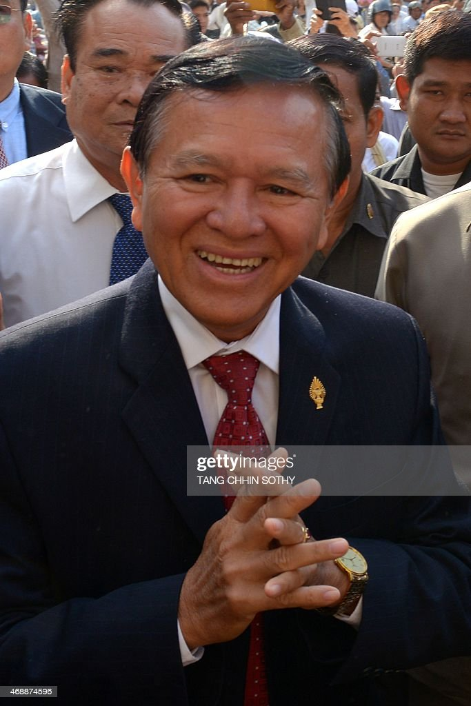 Cambodian opposition party deputy leader <a gi-track='captionPersonalityLinkClicked' href=/galleries/search?phrase=Kem+Sokha&family=editorial&specificpeople=659005 ng-click='$event.stopPropagation()'>Kem Sokha</a> greets people in front of the Phnom Penh municipal court on April 8, 2015. Sokha appeared at a court for questioning over a demonstration after the general election in July 2013.