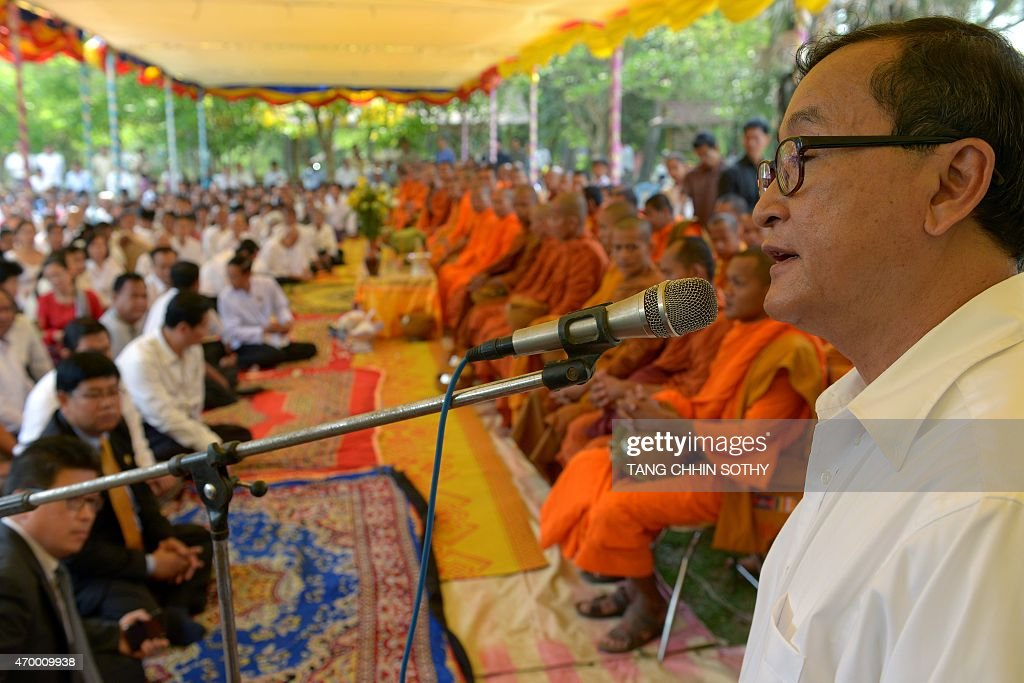 Cambodian opposition party leader Sam Rainsy addresses people at Choeung Ek killing fields memorial in Phnom Penh on April 17 2015 Tearful survivors...