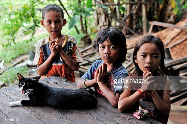 Cambodian orphans pose for photograph in a nongovernment orphanage on September 28 2013 in Siem Reap Cambodia The devastation caused by the Khmer...