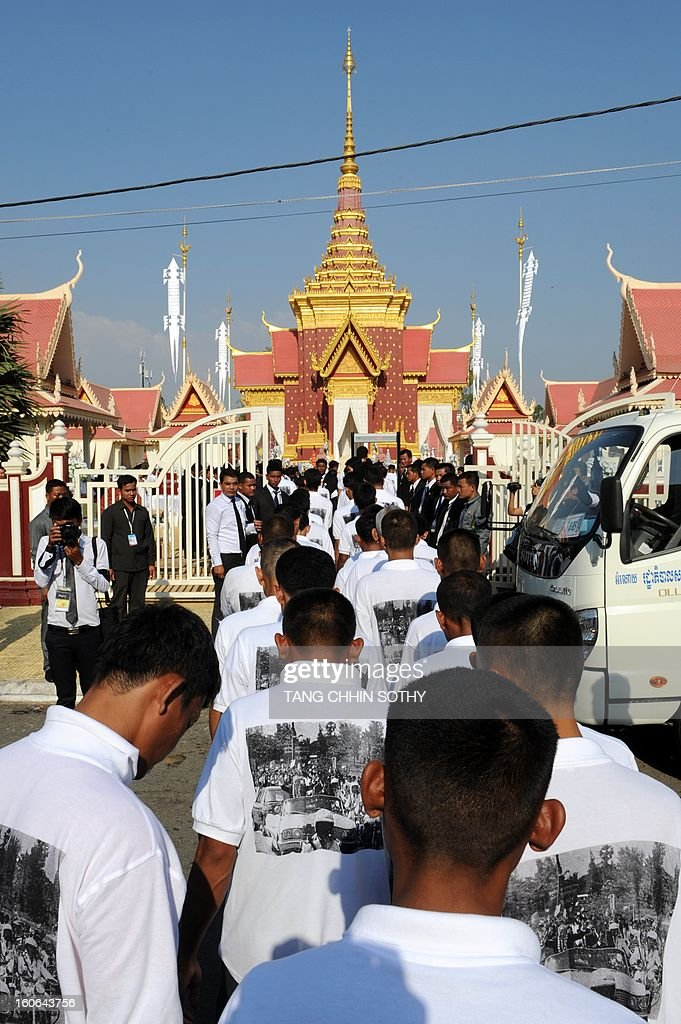 Cambodian pardoned prisoners walk into the cremation site during the cremation of Cambodia's King Norodom Sihanouk near the Royal Palace in Phnom Penh on February 4, 2013. Thousands of mourners massed in the Cambodian capital as the kingdom cremated its revered former King Norodom Sihanouk, who steered his country through six turbulent decades.