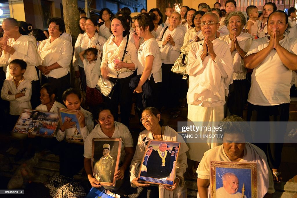 Cambodian people cry during the cremation of the late former King Norodom Sihanouk at the cremation site near the Royal Palace in Phnom Penh on February 4, 2013. Thousands of mourners massed in the Cambodian capital as the kingdom cremated its revered former king Norodom Sihanouk, who steered his country through six turbulent decades.