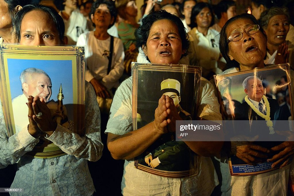 Cambodian people cry during the cremation of the late former King Norodom Sihanouk at the cremation site near the Royal Palace in Phnom Penh on February 4, 2013. Thousands of mourners massed in the Cambodian capital on February 4, as the kingdom cremated its revered former king Norodom Sihanouk, who steered his country through six turbulent decades.