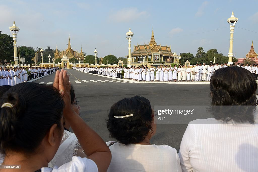 Cambodian people pray during a funeral of the late former King Norodom Sihanouk in front of the Royal Palace in Phnom Penh on February 7, 2013 following his cremation on February 4. Cambodia ended the week-long lavish funeral of its revered former King Norodom Sihanouk on February 7, by bringing his bones back to the royal palace.