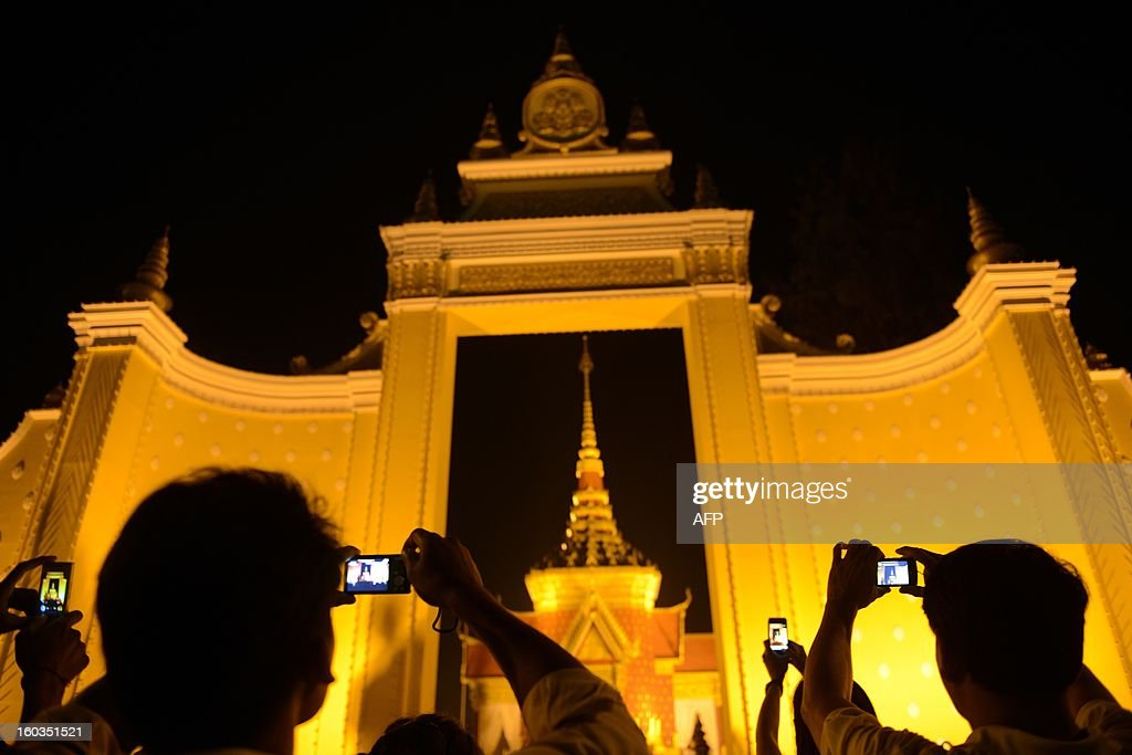 Cambodian people take pictures of the cremation site for the late former King Norodom Sihanouk near the Royal Palace in Phnom Penh on January 29, 2013. Cambodia on January 30, braced for an elaborate funeral for revered former King Norodom Sihanouk, who died aged 89 and will be cremated on February 4. AFP PHOTO / TANG CHHIN SOTHY