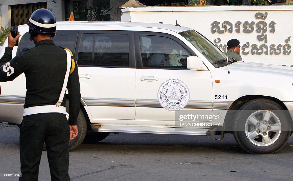 A Cambodian Police Stand Guards As A UN-back Court's Car