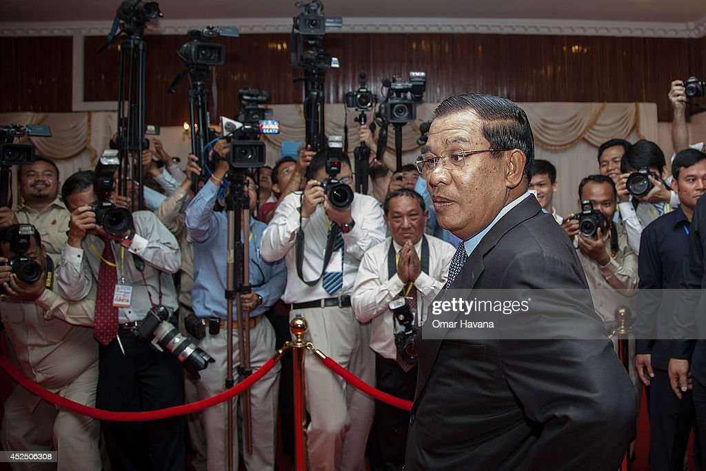Cambodian Prime Minister <a gi-track='captionPersonalityLinkClicked' href=/galleries/search?phrase=Hun+Sen&family=editorial&specificpeople=224084 ng-click='$event.stopPropagation()'>Hun Sen</a> addresses the media before a meeting with Sam Rainsy, President of the opposition Cambodia National Rescue Party, aimed at resolving the year-long political deadlock on July 22, 2014 in Phnom Penh, Cambodia. Cambodian Prime Minister <a gi-track='captionPersonalityLinkClicked' href=/galleries/search?phrase=Hun+Sen&family=editorial&specificpeople=224084 ng-click='$event.stopPropagation()'>Hun Sen</a> meets today with the President of the opposition Cambodia National Rescue Party, Sam Rainsy, for 'final talks' on an agreement to end the year-long political deadlock between the ruling Cambodian People's Party and the CNRP, a week after eight CNRP Members of Parliament-elect were arrested and charged with crimes of insurrection and incitement to violence. The deal on the table is based on a principle agreement dating back to April 2014 between <a gi-track='captionPersonalityLinkClicked' href=/galleries/search?phrase=Hun+Sen&family=editorial&specificpeople=224084 ng-click='$event.stopPropagation()'>Hun Sen</a> and Sam Rainsy, which includes a February 2018 national election and reform of the National Election Committee.