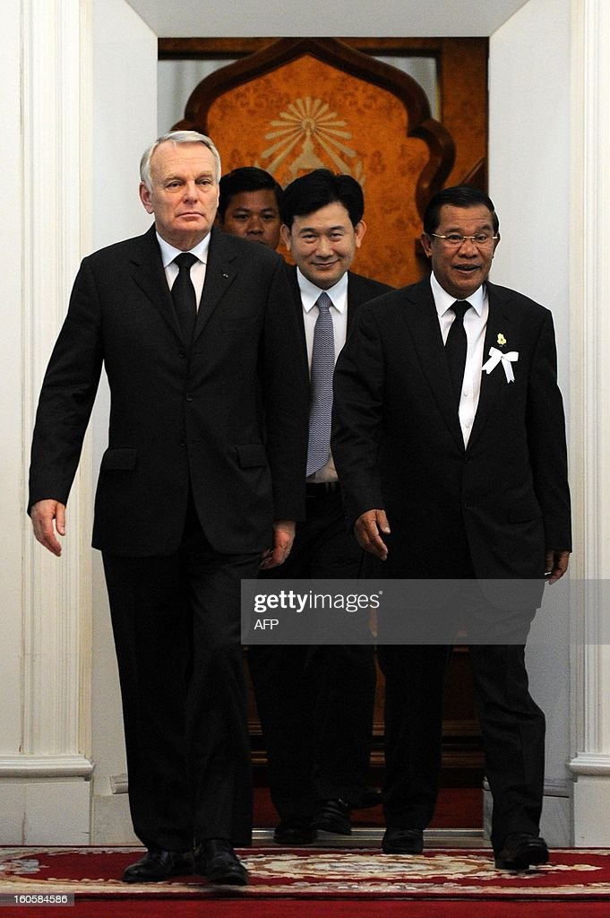 Cambodian Prime Minister Hun Sen (R) and France Prime Minister Jean-Marc Ayrault (L) walk to a meeting at the Peace Palace in Phnom Penh on February 3, 2013. French Prime Minister Jean-Marc Ayrault on Sunday paid tribute to Cambodia's late former king Norodom Sihanouk, a passionate francophile who won independence from the one-time colonial power.