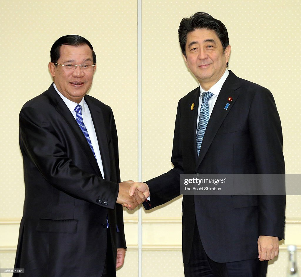 Cambodian Prime Minister <a gi-track='captionPersonalityLinkClicked' href=/galleries/search?phrase=Hun+Sen&family=editorial&specificpeople=224084 ng-click='$event.stopPropagation()'>Hun Sen</a> (L) and Japanese Prime Minister <a gi-track='captionPersonalityLinkClicked' href=/galleries/search?phrase=Shinzo+Abe&family=editorial&specificpeople=559017 ng-click='$event.stopPropagation()'>Shinzo Abe</a> (R) shake hands during their meeting on the sidelines of the U.N. World Conference on Disastere Risk Reduction on March 15, 2015 in Sendai, Miyagi, Japan. More than 40,000 people are expected to take part in the conference, which is being held in the Sendai International Center and other venues through March 18. The participants include government representatives and NGO members from more than 170 countries.