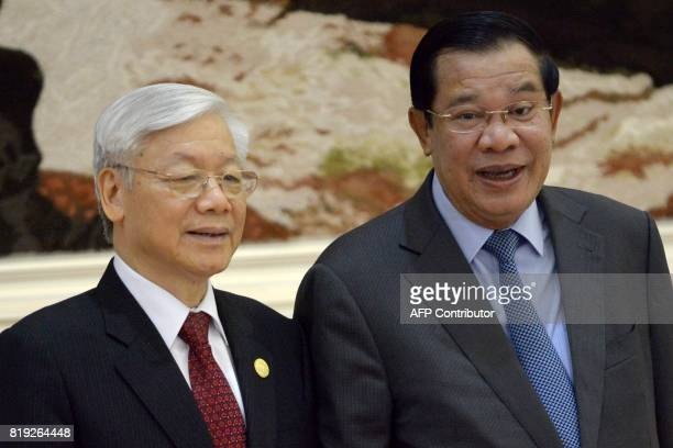 Cambodian Prime Minister Hun Sen and Vietnam's Communist Party Secretary General Nguyen Phu Trong pose for a picture upon arrival at the Peace Palace...