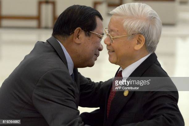 Cambodian Prime Minister Hun Sen hugs Vietnam's Communist Party Secretary General Nguyen Phu Trong upon arrival at the Peace Palace in Phnom Penh on...