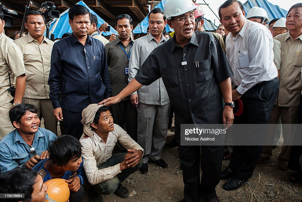 Cambodian Prime Minister <a gi-track='captionPersonalityLinkClicked' href=/galleries/search?phrase=Hun+Sen&family=editorial&specificpeople=224084 ng-click='$event.stopPropagation()'>Hun Sen</a> makes his first public visit to the construction site of a bridge South of Phnom Penh on July 31, 2013 in Phnom Penh, Cambodia. During his first public address since the election, PM <a gi-track='captionPersonalityLinkClicked' href=/galleries/search?phrase=Hun+Sen&family=editorial&specificpeople=224084 ng-click='$event.stopPropagation()'>Hun Sen</a> said he would welcome the international community, all political parties and the National Election Committee to investigate allegations of voter fraud during the General Elections held on July 28th, 2013.