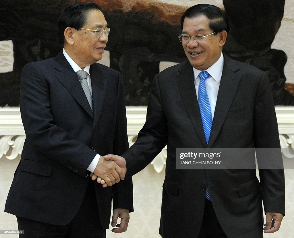 Cambodian Prime Minister <a gi-track='captionPersonalityLinkClicked' href=/galleries/search?phrase=Hun+Sen&family=editorial&specificpeople=224084 ng-click='$event.stopPropagation()'>Hun Sen</a> (R) shakes hands with Laos President <a gi-track='captionPersonalityLinkClicked' href=/galleries/search?phrase=Choummaly+Sayasone&family=editorial&specificpeople=556173 ng-click='$event.stopPropagation()'>Choummaly Sayasone</a> (L) during a meeting at the Peace Palace in Phnom Penh on February 26, 2015. Choummaly arrived earlier for a two-day official visit.