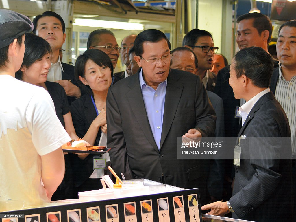 Cambodian Prime Minister <a gi-track='captionPersonalityLinkClicked' href=/galleries/search?phrase=Hun+Sen&family=editorial&specificpeople=224084 ng-click='$event.stopPropagation()'>Hun Sen</a> smiles as he eats sushi at Karato Market on July 5, 2011 in Shimonoseki, Yamaguchi, Japan. <a gi-track='captionPersonalityLinkClicked' href=/galleries/search?phrase=Hun+Sen&family=editorial&specificpeople=224084 ng-click='$event.stopPropagation()'>Hun Sen</a> is in Japan to attend the Japan-Mekon Summit.