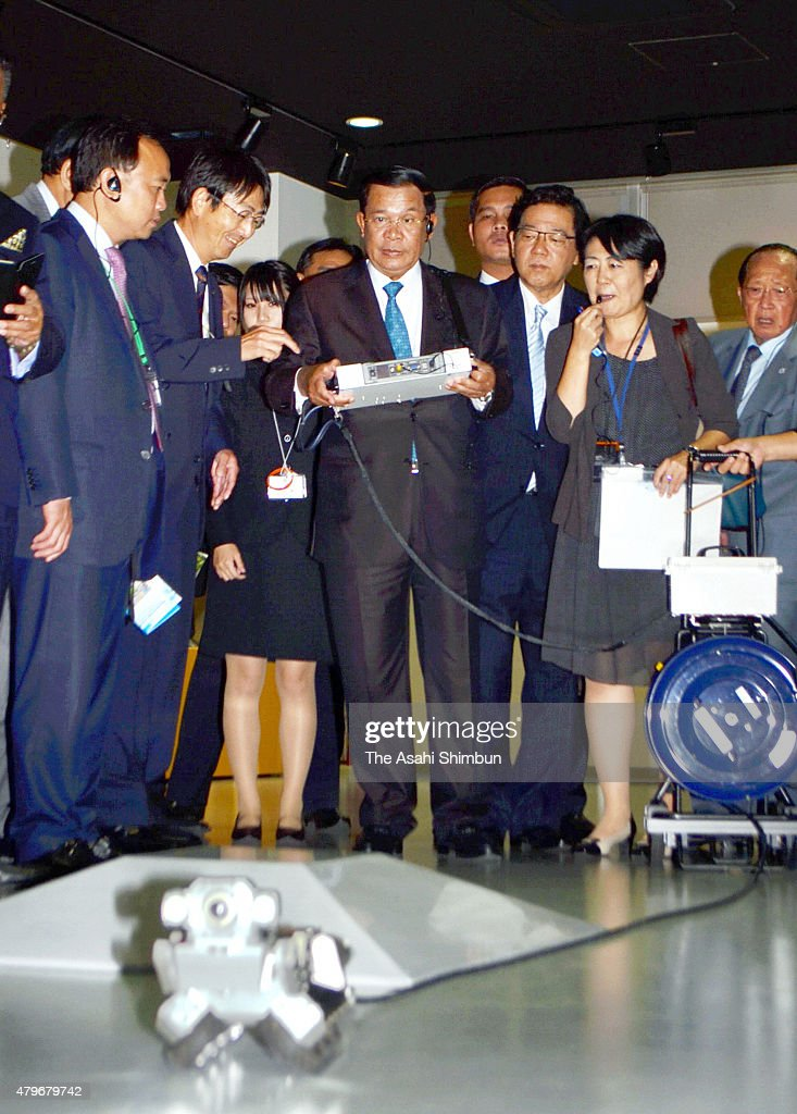 Cambodian Prime Minister <a gi-track='captionPersonalityLinkClicked' href=/galleries/search?phrase=Hun+Sen&family=editorial&specificpeople=224084 ng-click='$event.stopPropagation()'>Hun Sen</a> smiles as he operates a sewerage tunnel investigation robot on July 5, 2011 in Kitakyushu, Fukuoka, Japan. <a gi-track='captionPersonalityLinkClicked' href=/galleries/search?phrase=Hun+Sen&family=editorial&specificpeople=224084 ng-click='$event.stopPropagation()'>Hun Sen</a> is in Japan to attend the Japan-Mekon Summit.