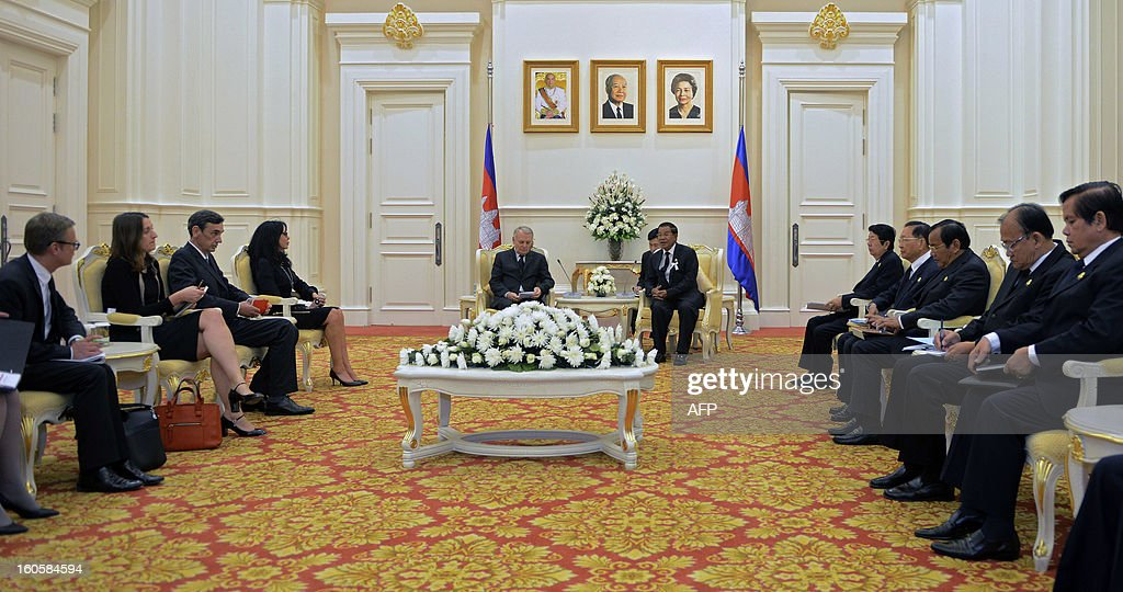 Cambodian Prime Minister Hun Sen (C-R) talks to French Prime Minister Jean-Marc Ayrault (C-L) during a meeting at the Peace Palace in Phnom Penh on February 3, 2013. French Prime Minister Jean-Marc Ayrault on Sunday paid tribute to Cambodia's late former king Norodom Sihanouk, a passionate francophile who won independence from the one-time colonial power.