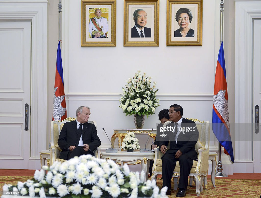 Cambodian Prime Minister Hun Sen (R) talks to French Prime Minister Jean-Marc Ayrault (L) during a meeting at the Peace Palace in Phnom Penh on February 3, 2013. French Prime Minister Jean-Marc Ayrault on Sunday paid tribute to Cambodia's late former king Norodom Sihanouk, a passionate francophile who won independence from the one-time colonial power.