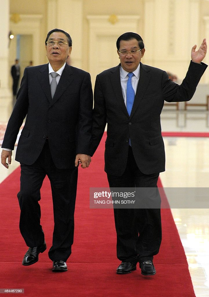 Cambodian Prime Minister <a gi-track='captionPersonalityLinkClicked' href=/galleries/search?phrase=Hun+Sen&family=editorial&specificpeople=224084 ng-click='$event.stopPropagation()'>Hun Sen</a> (R) walks with Laos President <a gi-track='captionPersonalityLinkClicked' href=/galleries/search?phrase=Choummaly+Sayasone&family=editorial&specificpeople=556173 ng-click='$event.stopPropagation()'>Choummaly Sayasone</a> (L) during their meeting at the Peace Palace in Phnom Penh on February 26, 2015. Choummaly arrived earlier for a two-day official visit.