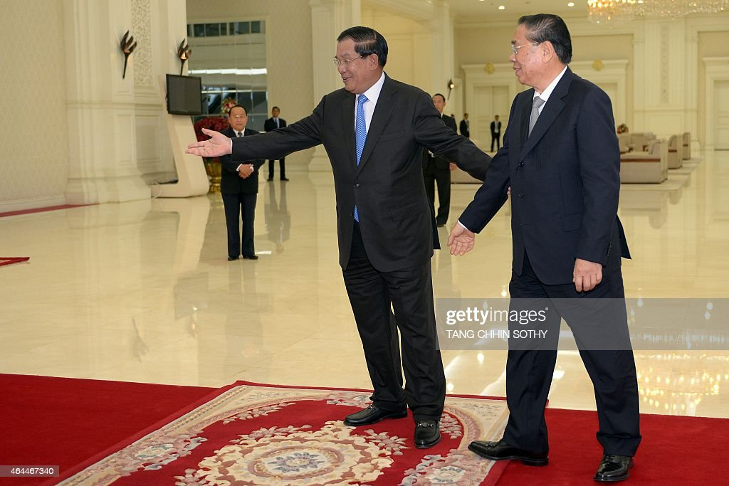 Cambodian Prime Minister <a gi-track='captionPersonalityLinkClicked' href=/galleries/search?phrase=Hun+Sen&family=editorial&specificpeople=224084 ng-click='$event.stopPropagation()'>Hun Sen</a> (C) welcomes Laos President <a gi-track='captionPersonalityLinkClicked' href=/galleries/search?phrase=Choummaly+Sayasone&family=editorial&specificpeople=556173 ng-click='$event.stopPropagation()'>Choummaly Sayasone</a> (R) during a meeting at the Peace Palace in Phnom Penh on February 26, 2015. Choummaly arrived earlier for a two-day official visit.