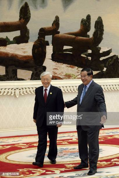 Cambodian Prime Minister Hun Sen welcomes Vietnam's Communist Party Secretary General Nguyen Phu Trong upon arrival at the Peace Palace in Phnom Penh...