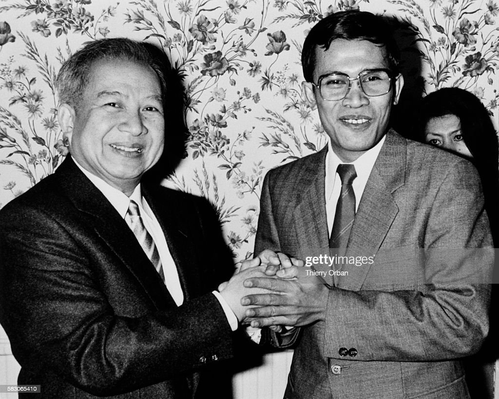 Cambodian Prince Norodom Sihanouk and Hun Sen Chairman of the Council of Ministers of Heng Samrin's government in Phnom Penh hold hands during a...