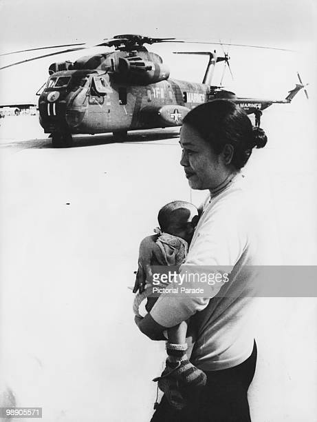 A Cambodian refugee and her child at an American military base at UTapao Thailand 13th April 1975 The woman has been evacuated from Phnom Penh which...
