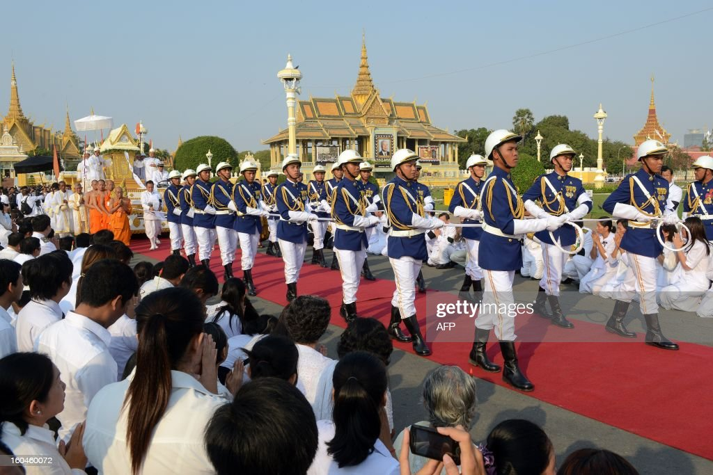 Cambodian Royal officials leads the Royal float during a funeral procession for the late former King Norodom Sihanouk in front of the Royal Palace in Phnom Penh on February 1, 2013. A sea of mourners filled the streets of the Cambodian capital Friday for a lavish funeral for revered former king Norodom Sihanouk, who towered over six tumultuous decades in his nation's history.