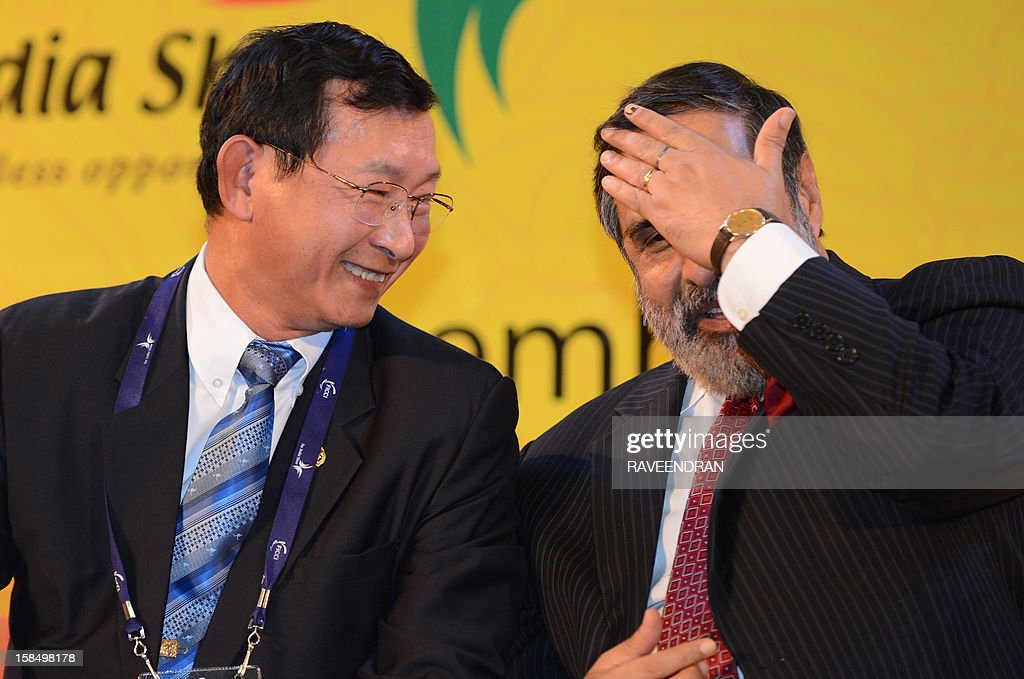 Cambodian senior Minister and Minister of Commerce, Cham Prasidh (L) shares a light moment with Indian Minister for Commerce and Industry Anand Sharma during the inauguration of the 2nd India-ASEAN Business Fair and Business Conclave in New Delhi on December 18, 2012. Trade and commerce ministers from ten ASEAN countries are attending the two-day conference.