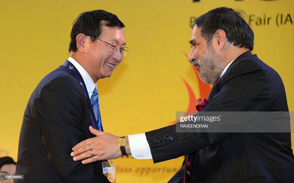 Cambodian Senior Minister and Minister of Commerce Cham Prasidh (L) is greeted by Indian Minister for Commerce and Industry, Anand Sharma during the inauguration of the 2nd India-ASEAN Business Fair and Business Conclave in New Delhi on December 18, 2012. Trade and commerce ministers from ten ASEAN countries are attending the two-day conference.