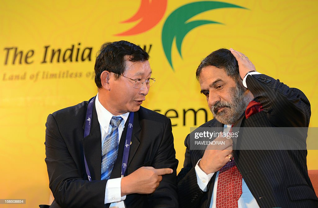 Cambodian Senior Minister and Minister of Commerce Cham Prasidh (L) talks with Indian Minister for Commerce and Industry Anand Sharma during the inauguration of the 2nd India-ASEAN Business Fair and Business Conclave in New Delhi on December 18, 2012. Trade and commerce ministers from ten ASEAN countries are attending the two-day conference. AFP PHOTO/RAVEENDRAN