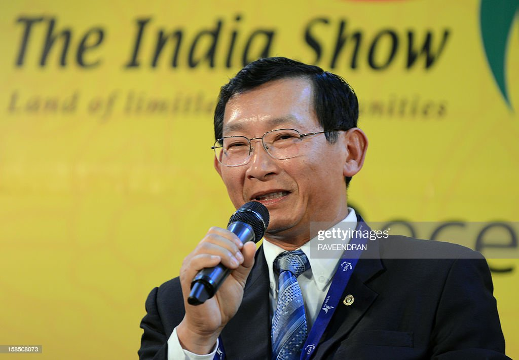 Cambodian Senior Minister and Minister of Commerce Cham Prasidh (L) speakds during the inauguration of the 2nd India-ASEAN Business Fair and Business Conclave in New Delhi on December 18, 2012. Trade and commerce ministers from ten ASEAN countries are attending the two-day conference. AFP PHOTO/RAVEENDRAN