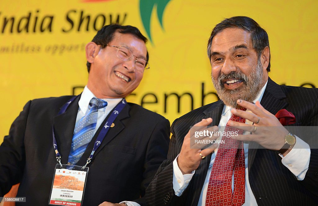 Cambodian Senior Minister and Minister of Commerce Cham Prasidh (L) listens to Indian Minister for Commerce and Industry Anand Sharma during the inauguration of the 2nd India-ASEAN Business Fair and Business Conclave in New Delhi on December 18, 2012. Trade and commerce ministers from ten ASEAN countries are attending the two-day conference.