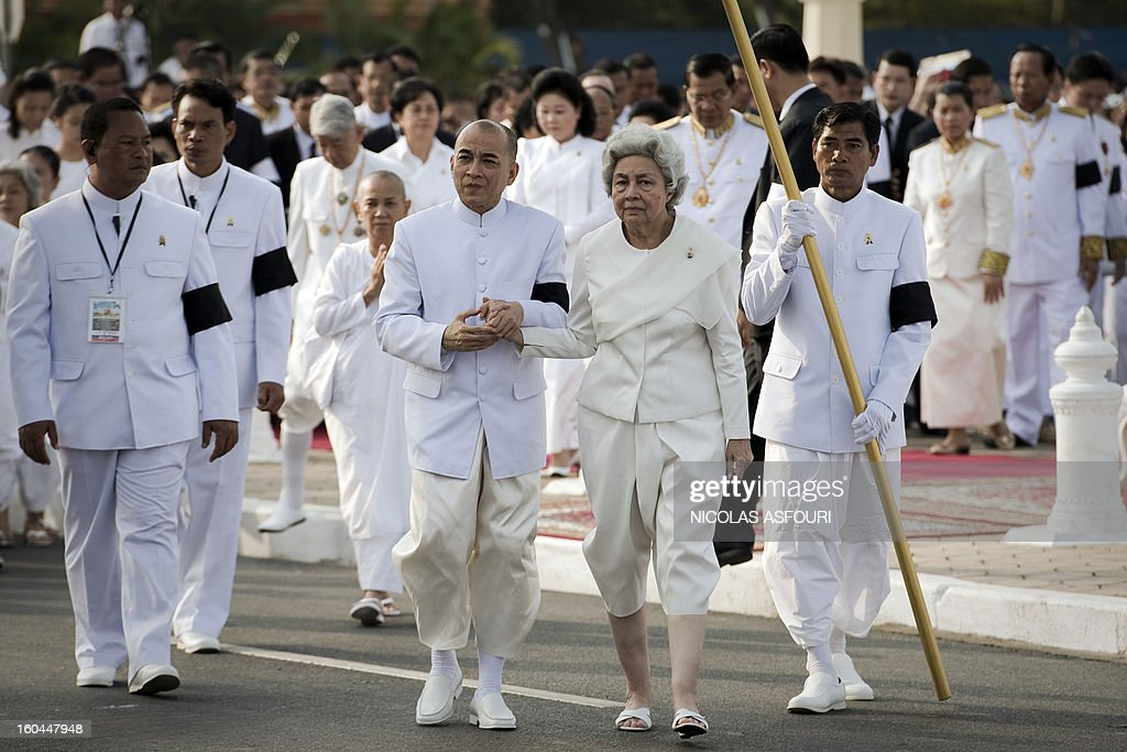 Cambodian Sihanouk's widow Queen Monique (Center-R) and King Norodom Sihamoni (Center L) walk during a funeral procession of the late former King Norodom Sihanouk in front of the Royal Palace in Phnom Penh on February 1, 20132013. Sihanouk, who abdicated in 2004 after steering Cambodia through six decades marked by independence from France, civil war, the murderous Khmer Rouge regime and finally peace, died of a heart attack in Beijing on October 15, 2012 and will be cremated on February 4. AFP PHOTO / Nicolas ASFOURI